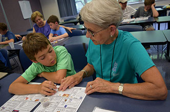 Grandson and grandmother in class together